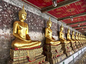 A golden Buddha statues in Wat Suthat Thepphawararam. Bangkok. T — Stock Photo