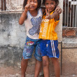 Two young girls posing outside in Siem Reap Cambodia — Stok fotoğraf