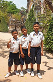 Three students posing in front of the temple of Wat Bo in Siem R — Stok fotoğraf
