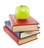Apple on top of stack of old books — Photo