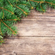 Christmas fir tree on a wooden background — Foto Stock