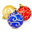 Three christmas balls on a white background — Stok fotoğraf