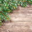 Christmas fir tree on a wooden background — ストック写真