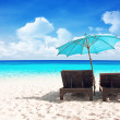 Stock Photo: Beach chairs with umbrella