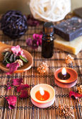Spa with natural bath salt, candles, soap, towels and petals — Photo
