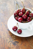 Fresh red cherries in a cup — Stock Photo