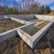 Concrete foundation for a new house - Stock Photo