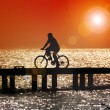 Bicycling at sunset — Stock Photo