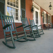 Rocking chairs on historic New England house — Stock Photo #25743241