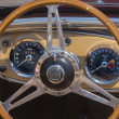 Sports car steering wheel and dashboard — Foto de Stock