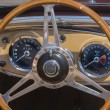 Sports car steering wheel and dashboard — Stok fotoğraf