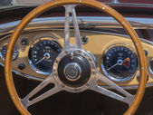 Sports car steering wheel and dashboard — Stock Photo