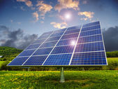 Solar panels in suburban field — Stock Photo
