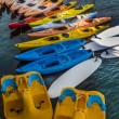Colorful kayaks and paddle boats — Stock Photo