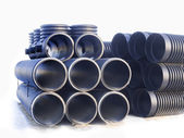 Large black plastic drain pipes — Stock Photo