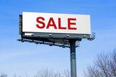 Sale on highway billboard sign — Stock Photo
