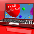 Stock Photo: Free Delivery Balloons On Computer Showing No Charge Or Gratis T