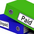 Stock Photo: Paid Unpaid Files Shows Overdue Invoices And Bills