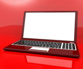Red Computer On Desk With White Copyspace — Stock Photo