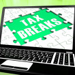 Tax Breaks On Laptop Shows Internet Paying - Foto Stock
