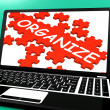 Stock Photo: Organize Puzzle On Notebook Shows Files Management