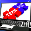 Team Work On Laptop Shows Unity — Stock Photo