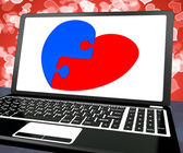Puzzle Heart On Laptop Shows Engagement — Stock Photo