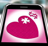Puzzle Heart On Smartphone Showing Commitment — Stock Photo