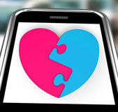 Two-Pieced Heart On Smartphone Showing Complement — Stock Photo