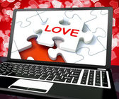 Love Puzzle On Laptop Shows Internet Dating — Stock Photo