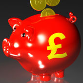 Coins Entering Piggybank Showing British Investing — Stock Photo