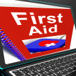 First Aid On Laptop Shows Medical Assistance — Stock Photo