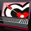 Stock Photo: Target Heart On Laptop Shows Affection