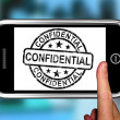 Confidential On Smartphone Shows Classified Information - Стоковая фотография