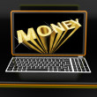 Stock Photo: Money On Laptop Showing Earnings