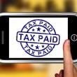 图库照片: Tax Paid On Smartphone Shows Payment Confirmation