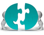 Jigsaw Pieces Being Joined Showing Teamwork And Togetherness — Stock Photo
