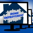 Stock Photo: Home Improvement On Monitors Shows Home Design Shows