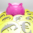 Piggybank Surrounded In Coins Showing European Incomes - Zdjęcie stockowe
