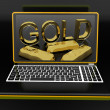 Gold On Laptop Showing Treasury — Stock Photo