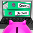 Stock Photo: Creditors And Debtors Files On Laptop Shows Financing