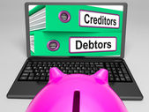 Creditors And Debtors Files On Laptop Shows Financing — Stock Photo