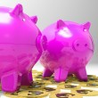 Stock Photo: Piggybanks On Euro Coins Showing Richness