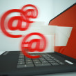 Foto Stock: Mail Signs Leaving Laptop Showing Outgoing Messages