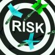 Stock Photo: Risk On Dartboard Shows Unsafe