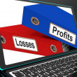 Profit And Looses Files On Laptop Showing Risky Trading — Stock Photo