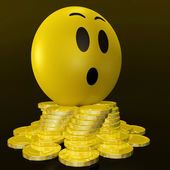 Surprised Smiley With Coins Shows Unexpected Earnings — Stock Photo
