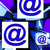 At Symbol On Cubes Showing Online Communication — Stock Photo