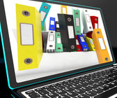 Falling Files On Laptop Showing Unorganized — Stock Photo