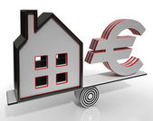 House And Euro Balancing Shows Investment — Stock Photo